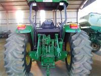 Trator John Deere 6415 4x4 ano 09